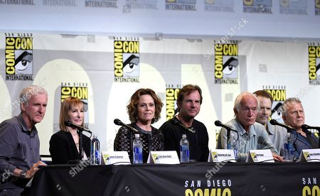 "Writer and director James Cameron, from left, producer Gale Anne Hurd, and actors Sigourney Weaver, Bill Paxton, Lance Henriksen, Michael Biehn, and Paul Reiser attend the ""Aliens: 30th Anniversary"" panel on day 3 of Comic-Con International, in San Diego"