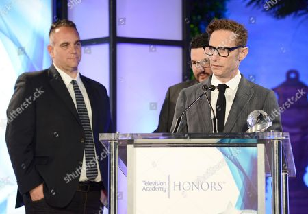 """Michael Begler accepts the Television Academy Honors Award for """"The Knick"""" at 2016 Television Academy Honors at The Montage Hotel, in Beverly Hills, Calif. Michael Sugar is seen on left"""