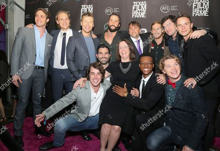 """Austin Film Society director Rebecca Campbell, bottom center, joins """"Everybody Wants Some"""" cast Temple Baker, Wyatt Russell, Glen Powell, Juston Street, director Richard Linklater, Austin Amelio, Forrest Vickery, Will Brittain, Tanner Kalina, Quinton Johnson, Tyler Hoechlin, and Blake Jenner, clockwise from top left, for a group photo at the 2016 Texas Film Awards at Austin Studios, in Austin, Texas"""