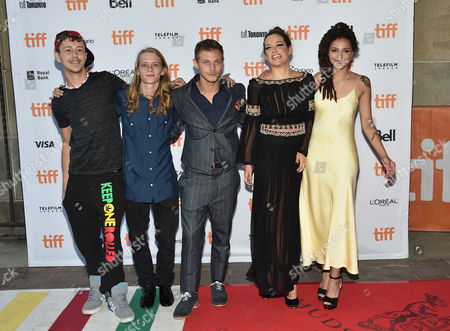 """Stock Photo of Raymond Coalson, from left, Isaiah Stone, McCaul Lombardi, Riley Keough and Sasha Lane arrive at the """"American Honey"""" premiere on day 4 of the Toronto International Film Festival at the Ryerson Theatre, in Toronto"""