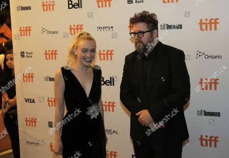 Dakota Fanning, left, and Martin Koolhoven attend the Brimstone premiere on day 5 of the Toronto International Film Festival at the Elgin Theatre, in Toronto