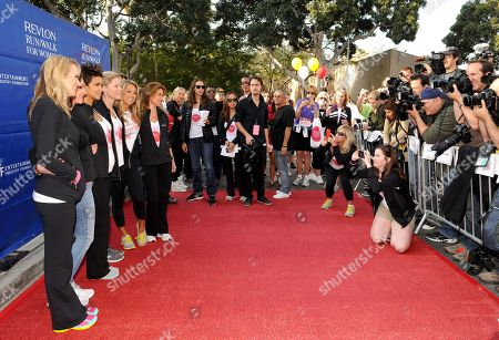 Stock Picture of L-R) Brooke Anderson, Lilly Tartikoff, Halle Berry, Julie Bowen, Denise Austin and Julia Goldin arrive at the 20th Annual EIF Revlon Run/Walk For Women held at Los Angeles Memorial Coliseum at Exposition Park on in Los Angeles, California