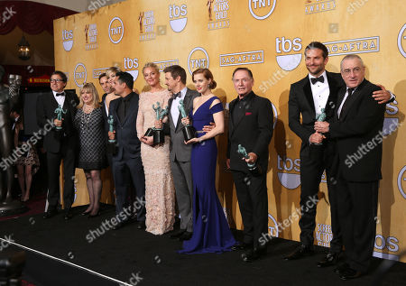 Stock Photo of From left, David O. Russell, Colleen Camp, Alessandro Nivola, Jennifer Lawrence, Michael Pena, Elisabeth Rohm, Jeremy Renner, Amy Adams, Paul Herman, Bradley Cooper and Robert De Niro pose in the press room with the award for outstanding performance by a cast in a motion picture for American Hustle at the 20th annual Screen Actors Guild Awards at the Shrine Auditorium, in Los Angeles