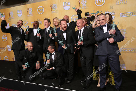 """Stock Picture of From left, back row Patrick Sane, Lavell Crawford, Bryan Cranston, Anna Gunn, Matthew T. Metzler, Aaron Paul, Dean Norris, RJ Mitte, Laura Fraser, Michael Bowen, Betsy Brandt, front from left, Tait Fletcher and Steven Michael Quezada The cast of """"Breaking Bad"""" pose in the press room with their awards for outstanding performance by an ensemble in a drama series for """"Breaking Bad"""" at the 20th annual Screen Actors Guild Awards at the Shrine Auditorium, in Los Angeles"""