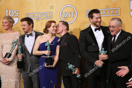 Stock Image of From left, Elisabeth Rohm, Jeremy Renner, Amy Adams, Paul Herman, Bradley Cooper and Robert De Niro pose in the press room with the award for outstanding performance by a cast in a motion picture for â?œAmerican Hustleâ?? at the Shrine Auditorium, in Los Angeles