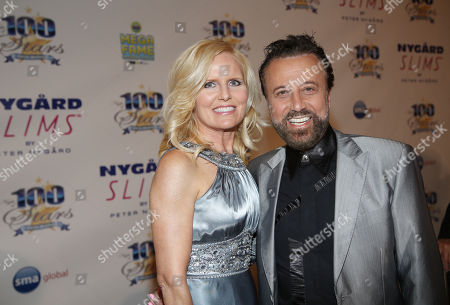Yakov Smirnoff, right, and guest arrive at the 24th Night of 100 Stars Oscars Viewing Gala at The Beverly Hills Hotel on in Beverly Hills, Calif