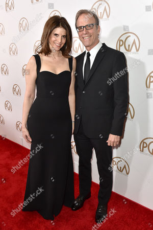 Amy Ziering, left, and Gil Kofman arrive at the 27th annual Producers Guild Awards at the Hyatt Regency Century Plaza, in Los Angeles