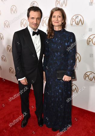 David Heyman, left, and Rose Uniacke arrive at the 27th annual Producers Guild Awards at the Hyatt Regency Century Plaza, in Los Angeles