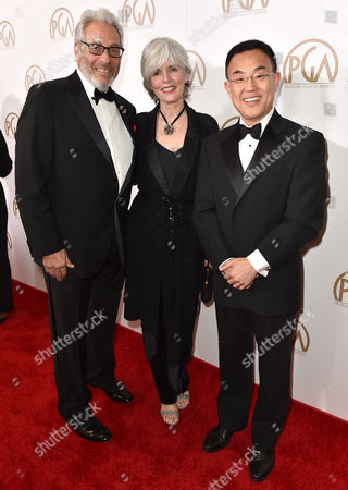 Hawk Koch, from left, Molly Koch and Dr. Jack Gao arrive at the 27th annual Producers Guild Awards at the Hyatt Regency Century Plaza, in Los Angeles