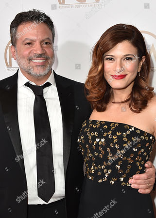 Michael De Luca, left, and Angelique Madrid arrive at the 27th annual Producers Guild Awards at the Hyatt Regency Century Plaza, in Los Angeles