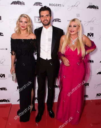 From left, Laurie Holden, Andrea Iervolino and Lady Monika Bacardi arrives at the 2nd Annual AMBI Gala at The Ritz-Carlton Hotel, in Toronto
