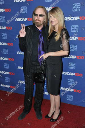 Tom Petty, left, and Dana York arrive at the 31st Annual ASCAP Pop Music Awards at the Loews Hollywood Hotel, in Los Angeles