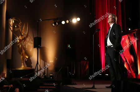 Graham Yost presents a College Television Award at the 35th College Television Awards, presented by the Television Academy Foundation at The Leonard H. Goldenson Theatre in the NoHo Arts District, in Los Angeles