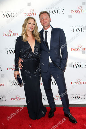 Stock Picture of Christina Applegate, left, and Martyn LeNoble attend The Dizzy Feet Foundation's 5th Annual Celebration of Dance Gala held at Club Nokia, in Los Angeles