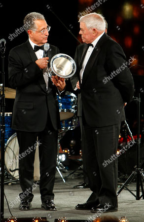 Tom T. Hall, right, accepts the Icon Award from Del Bryant at the 60th Annual BMI Country Awards, in Nashville, Tenn