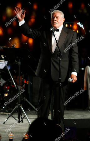 Stock Picture of Tom T. Hall waves to the crowd after receiving the Icon Award at the 60th Annual BMI Country Awards, in Nashville