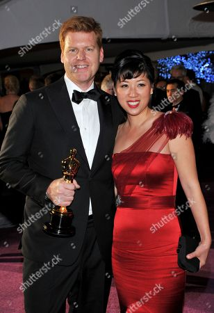 """John Kahrs, winner of the award for best animated short film for """"Paperman"""" and guest arrive at the Governor's Ball following the Oscars at the Dolby Theatre, in Los Angeles"""