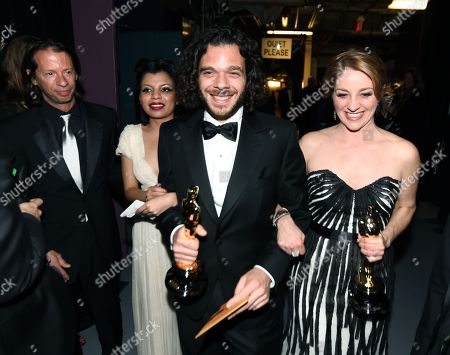 "Stock Image of From right, Andrea Nix Fine, Sean Fine and Inocente Izucar are seen backstage with the award for best documentary short for ""Inocente"" backstage at the Oscars at the Dolby Theatre, in Los Angeles"