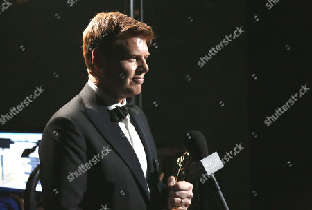 """John Kahrs accepts the award for best animated short film for """"Paperman"""" backstage at the Oscars at the Dolby Theatre, in Los Angeles"""