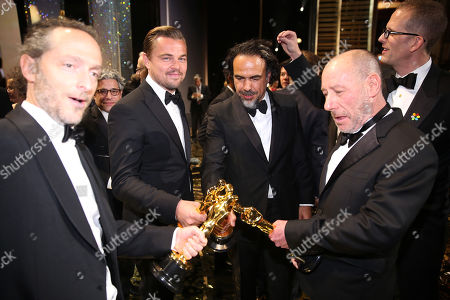 Emmanuel Lubezki with the award for best cinematography for The Revenant, from left, Leonardo DiCaprio with the award for best actor in a leading role for The Revenant, Alejandro G. Inarritu with the award for best director for The Revenant, and Chris Jenkins with the award for best sound mixing for Mad Max: Fury Road appear backstage at the Oscars, at the Dolby Theatre in Los Angeles