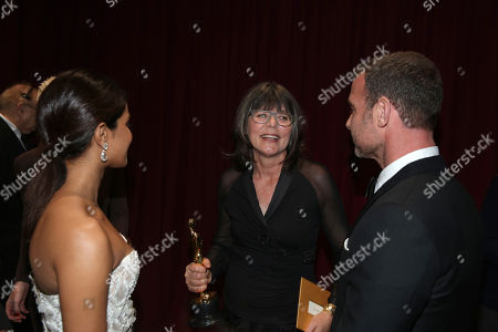 Priyanka Chopra, left, and Liev Schreiber, right, with Margaret Sixel, winner of the award for best film editing for Mad Max: Fury Road, converse backstage at the Oscars, at the Dolby Theatre in Los Angeles