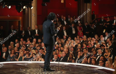 Alejandro G. Inarritu is seen from backstage as he accepts the award for best director for â?œThe Revenantâ?? at the Oscars, at the Dolby Theatre in Los Angeles