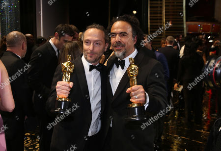 Emmanuel Lubezki, winner of the award for best cinematography for The Revenant, left, and Alejandro G. Inarritu, winner of the award for best director for The Revenant, appear backstage at the Oscars, at the Dolby Theatre in Los Angeles