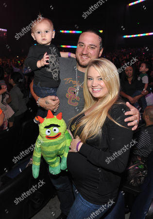 Stock Picture of From right, Tiffany Thornton is seen with husband Christopher Carney and son Kenneth Carney at A Very Awesome Yo Gabba Gabba! Live! Holiday Show, on at Nokia Theater, L.A. Live in Los Angeles