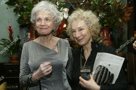 Alice Munro, left, and Margaret Atwood speak together at the National Arts Club, in New York, before Munro receives the National Arts Club's 37th Annual Medal of Honor for Literature