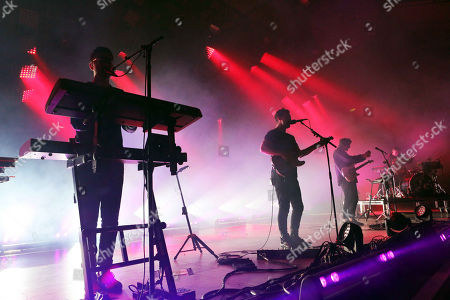 Joe Newman, Thom Green, Gus Unger-Hamilton and Cameron Knight with alt-J performs at Chastain Park Amphitheatre, in Atlanta