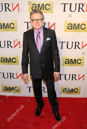 Stock Photo of Actor Kevin R. McNally attends the premiere of AMC's new series TURN at The National Archives on in Washington, DC