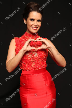 Real Housewives Of Miami Karent Sierra poses backstage at the American Heart Association's Miami Red Dress Fashion Show during Funkshionâ?™s Fall Fashion Week Miami Beach on in Miami Beach, FL