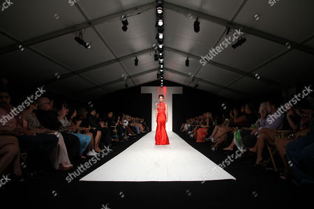 Real Housewives Of Miami Karent Sierra walks the runway at the American Heart Association's Miami Red Dress Fashion Show during Funkshionâ?™s Fall Fashion Week Miami Beach on in Miami Beach, FL