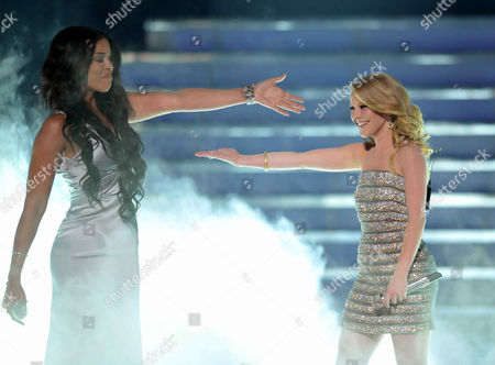 Hollie Cavanagh, right, and Jordin Sparks perform onstage at the American Idol Finale on in Los Angeles