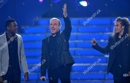 From left, Joshua Ledet, Neil Diamond and Deandre Brackensick perform onstage at the American Idol Finale on in Los Angeles