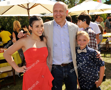 """Chris Meledandri, center, producer of """"Despicable Me 2,"""" poses with cast members Dana Gaier, left, and Elsie Fisher at the American premiere of the film at Universal Citywalk on in Universal City, Calif"""