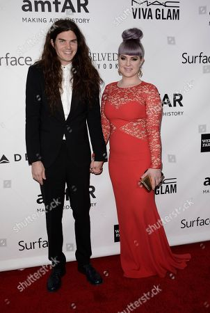 Singer Kelly Osbourne, right, and her boyfriend Matthew Mosshart arrive at the fourth annual amfAR Inspiration Gala at Milk Studios on in Los Angeles