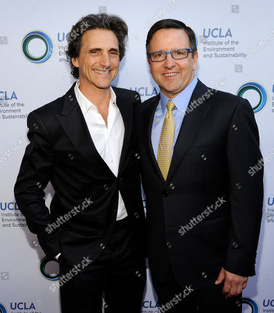 Stock Image of Honoree Lawrence Bender, left, poses with Tony Pritzker at the UCLA Institute of the Environment and Sustainability's An Evening of Environmental Excellence on in Beverly Hills, Calif