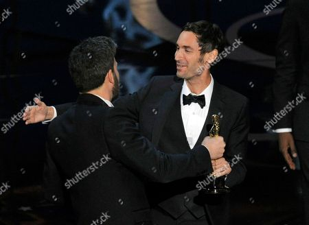 """Actor Ben Affleck, left, presents the award for best documentary feature to Malik Bendjelloul for """"Searching for Sugar Man"""" during the Oscars at the Dolby Theatre, in Los Angeles"""