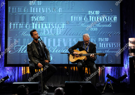 Kamar de los Reyes, left, and Jack Wall perform at the ASCAP Film and Television Awards at the Beverly Hilton Hotel on in Beverly Hills, Calif