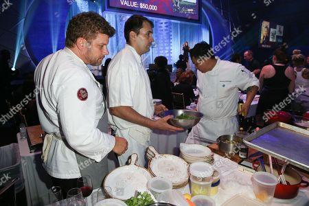 Chef Ben Ford prepares a dinner the Autism Speaks to LA Celebrity Chef Gala at Barker Hangar, in Santa Monica, Calif