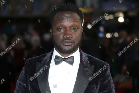 Actor Arnold Oceng poses for photographers upon arrival at the premiere of the film 'A United Kingdom', which opens the London Film Festival in London, . The festival runs from Oct. 5 until Oct. 16