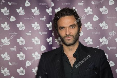 Actor Virgile Bramly poses for photographers upon arrival at the premiere of the film 'Alleycats', in London