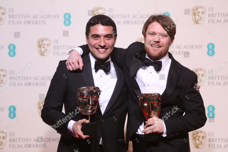 Director Naji Abu Nowar, left, and producer Rupert Lloyd pose with their awards for Outstanding Debut for the film 'Theeb' poses backstage at the BAFTA 2016 film awards at the Royal Opera House in London