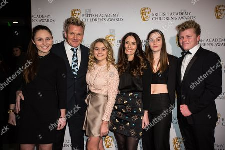 From left, Megan Ramsay, Gordon Ramsay, Matilda Ramsay, Tana Ramsay, Holly Ramsay and Jack Ramsay pose for photographers upon arrival at the BAFTA Children's awards, in London