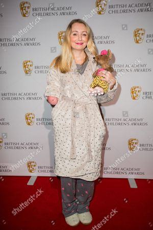 Cerrie Burnell poses for photographers upon arrival at the BAFTA Children's awards, in London
