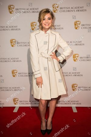 Georgia Lock poses for photographers upon arrival at the BAFTA Children's awards, in London