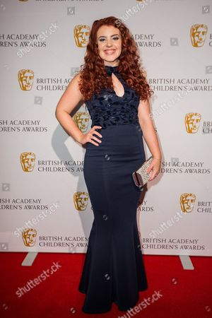 Leona Vaughan poses for photographers upon arrival at the BAFTA Children's awards, in London