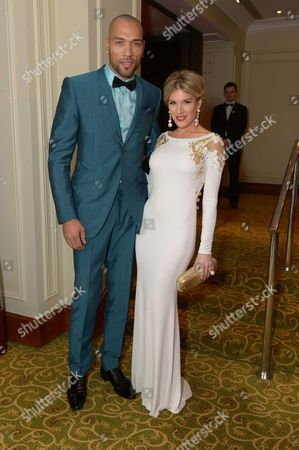 John Carew and Hofit Golan attend the EE British Academy Film Awards Official After Party at the Grosvenor House Hotel, in London