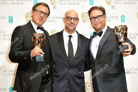 Stock Image of Stanley Tucci, centre with David O'Russell and Eric Warren Singer, winners of best original screenplay for American Hustle, pose for photographers in the winners room at the EE British Academy Film Awards held at the Royal Opera House, in London